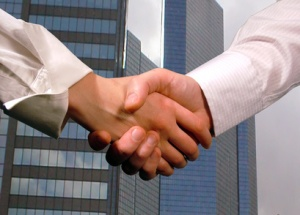 business handshake ,woman and man
