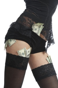 Beautiful legs and money for a white background