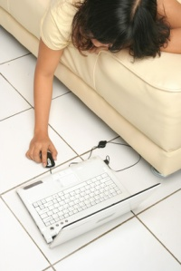 using laptop on the floor