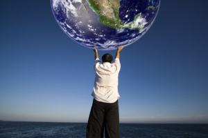 Man with white shirt holding the planet earth